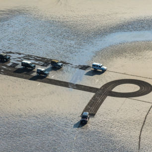 1Km sand drawing, made with Land Rovers, for Land Rover, Red Wharf Bay, Wales
