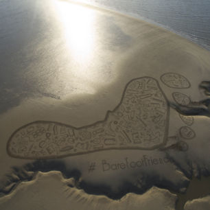 Barefoot Wine Beach Rescue 150metre Sand Drawing with Surfers Against Sewage